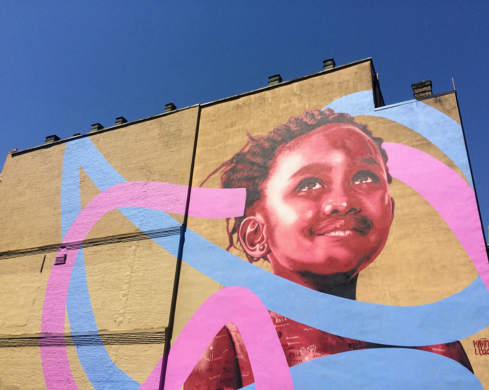 Portrait of a young girl titled Under the Same Sky by Kevin Ledo