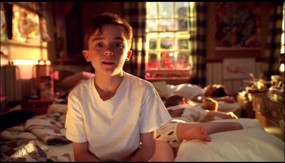 Figure 4.25 Malcolm speaks directly to the Malcolm in the Middle viewer, while his brother sleeps behind him.