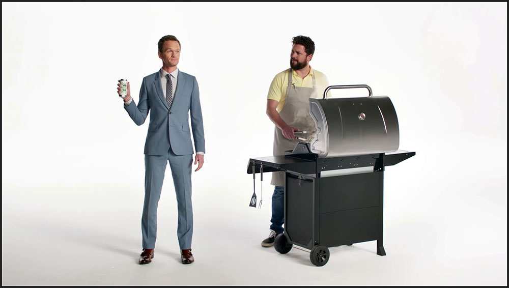 "Figure 6.8 Neil Patrick Harris offers to ""flip the meat"" of the Grill Master, toying with a gay subtext without making it explicit."
