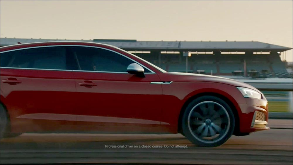 Figure 6.14 An Audi S5 Sportback accelerates down a horse racetrack, intercut with shots of . . .