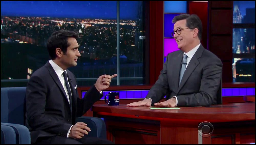 Figure 8.10 Stephen Colbert, behind a conventional desk, interviews Kumail Nanjiani on The Late Show.