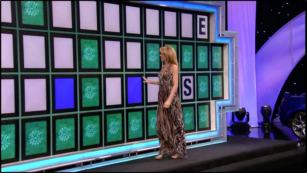 Figure 8.13 Letters are revealed as part of the game play on Wheel of Fortune.