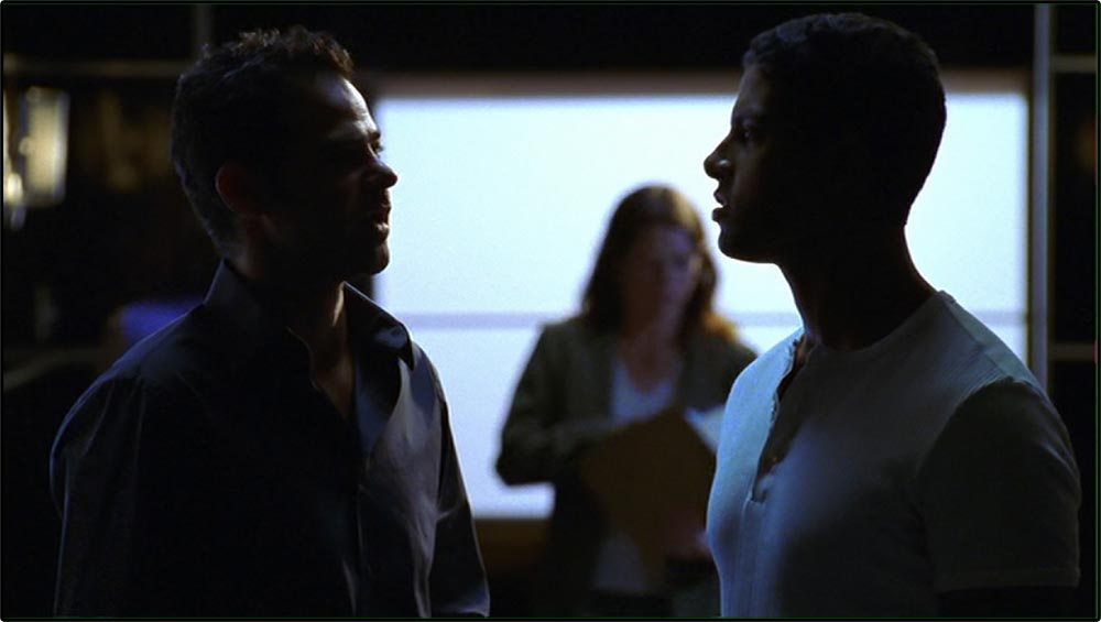 Figure 8.26 Backlighting silhouettes the actors and adds to the mystery of CSI: Miami.