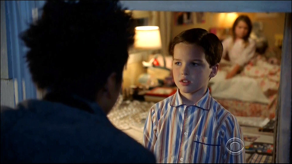 Figure 8.38 A scene from Young Sheldon is blocked in deep space, but shallow focus. Tam (foreground) tries to convince Sheldon to come to a party while behind him, out of focus, his sister, Missy, eagerly agrees.