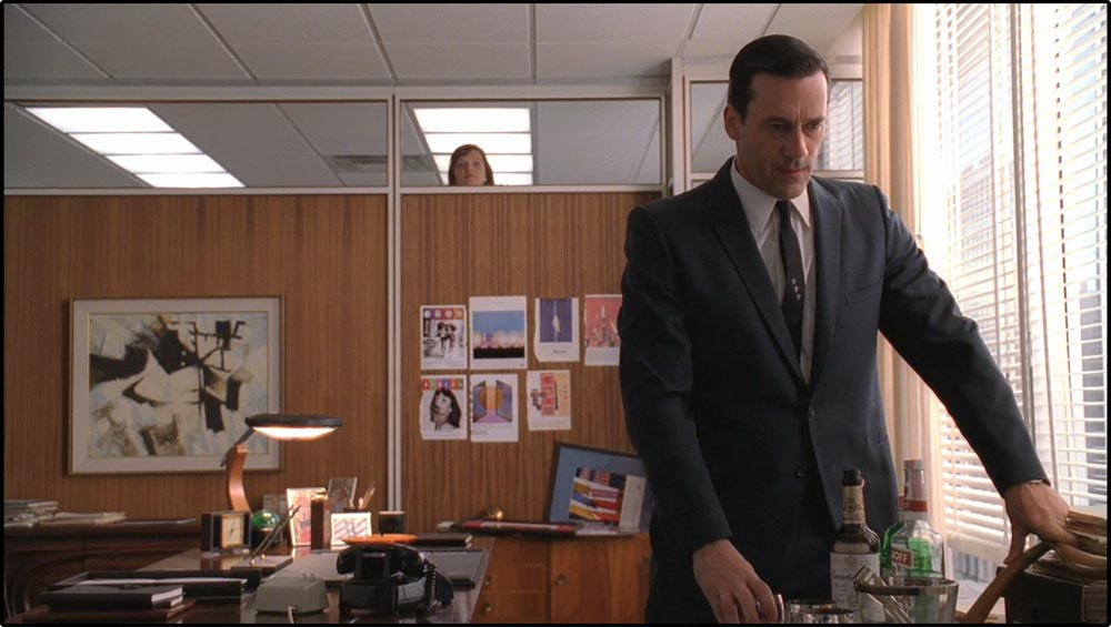 Figure 9.12 In deep focus and deep space, Peggy spies on Don in Mad Men.