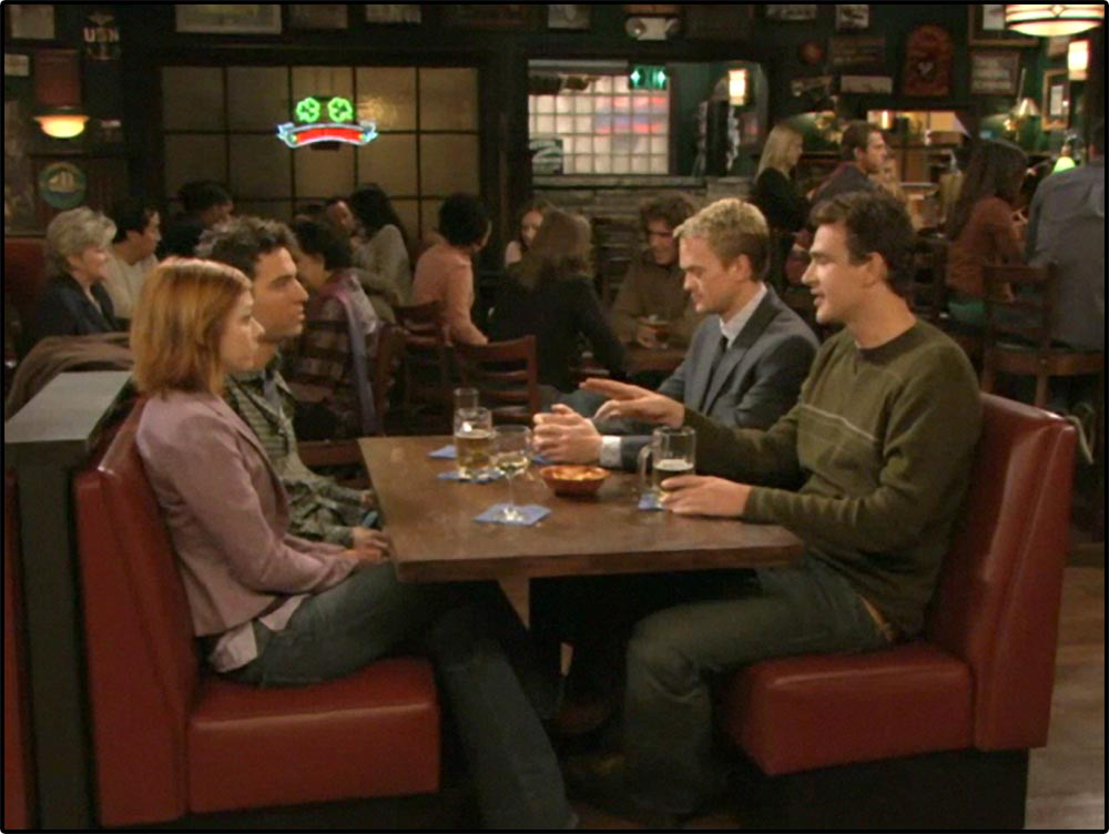 Figure 10.41 A long shot establishes the characters of How I Met Your Mother in their favorite bar and sets up an axis of action.