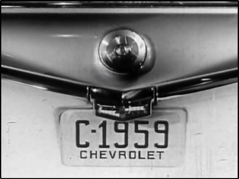 Figure 13.7 The opening shot of a 1959 Chevrolet car commercial tracks back from a close-­up of a license plate . . .