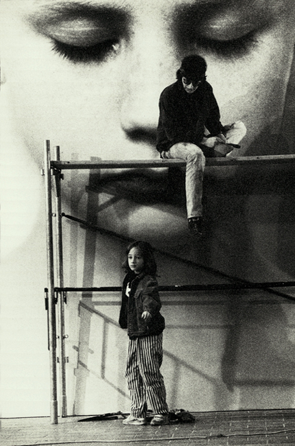 "Helnwein working on ""Head of a Child"" and his son Ali"