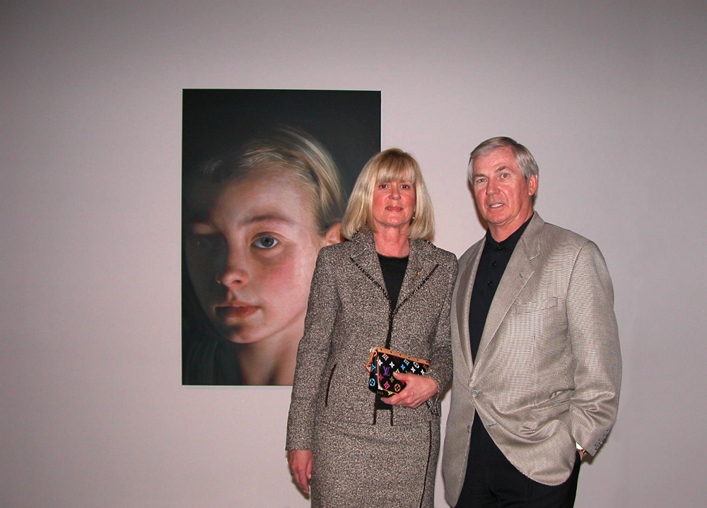 "Vicki and Kent Logan in front of Helnwein's ""Head of a Child 5"""