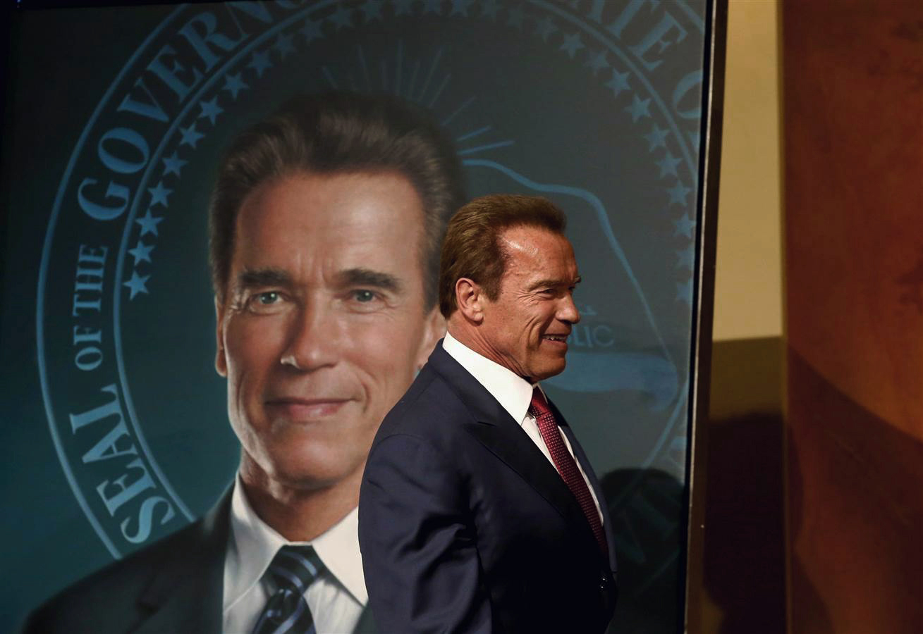 Former Gov. Arnold Schwarzenegger revealing the official portrait at a ceremony in the state Capitol