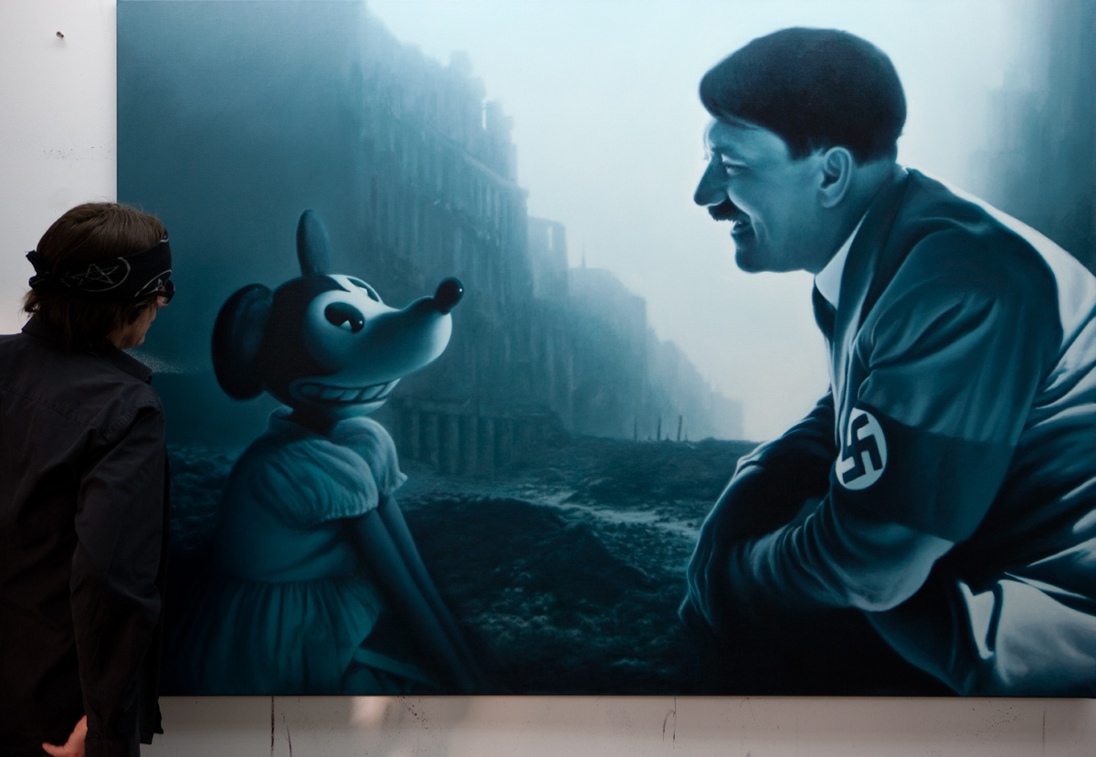 Helnwein with the painting 'The Man who Laughs'
