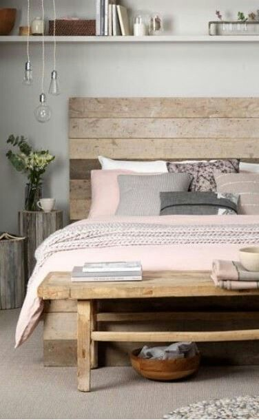 Pallets Have Been Deconstructed And Their Wood Used To Build A Simple Yet  Elegant Bed Frame Decorated With Feminine Pink Bed Covers.