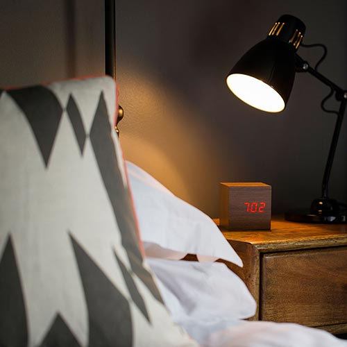 Side table with alarm clock and lamp