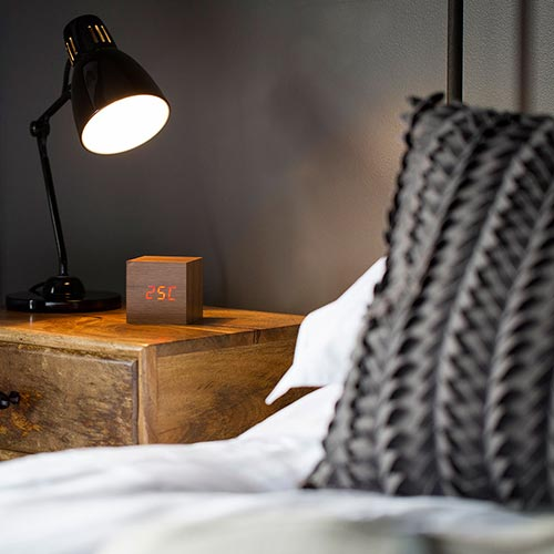 Bedside table with alarm clock and lamp