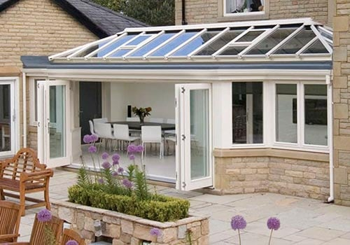 Conservatories from Ultraframe | Bifold doors open the space right up