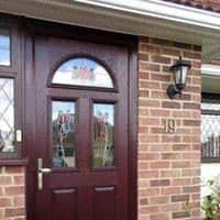 TPS | Recently fitted traditional dark wood door