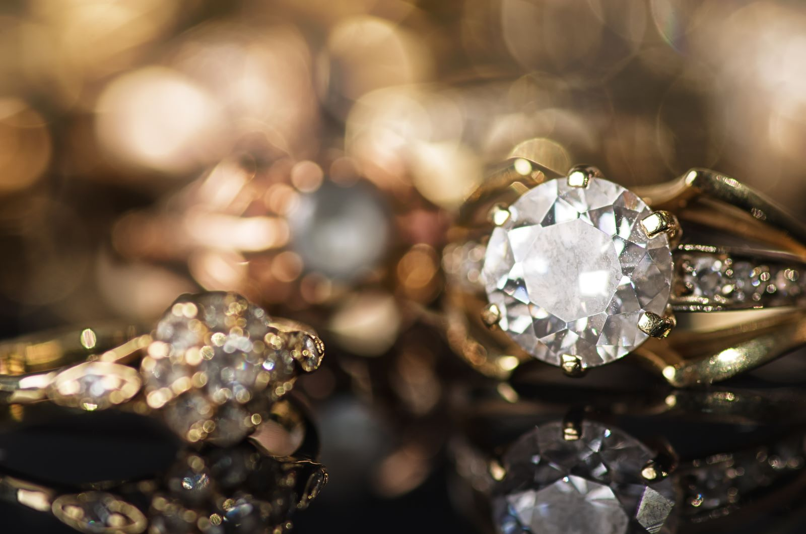 Closeup of gold rings with diamonds