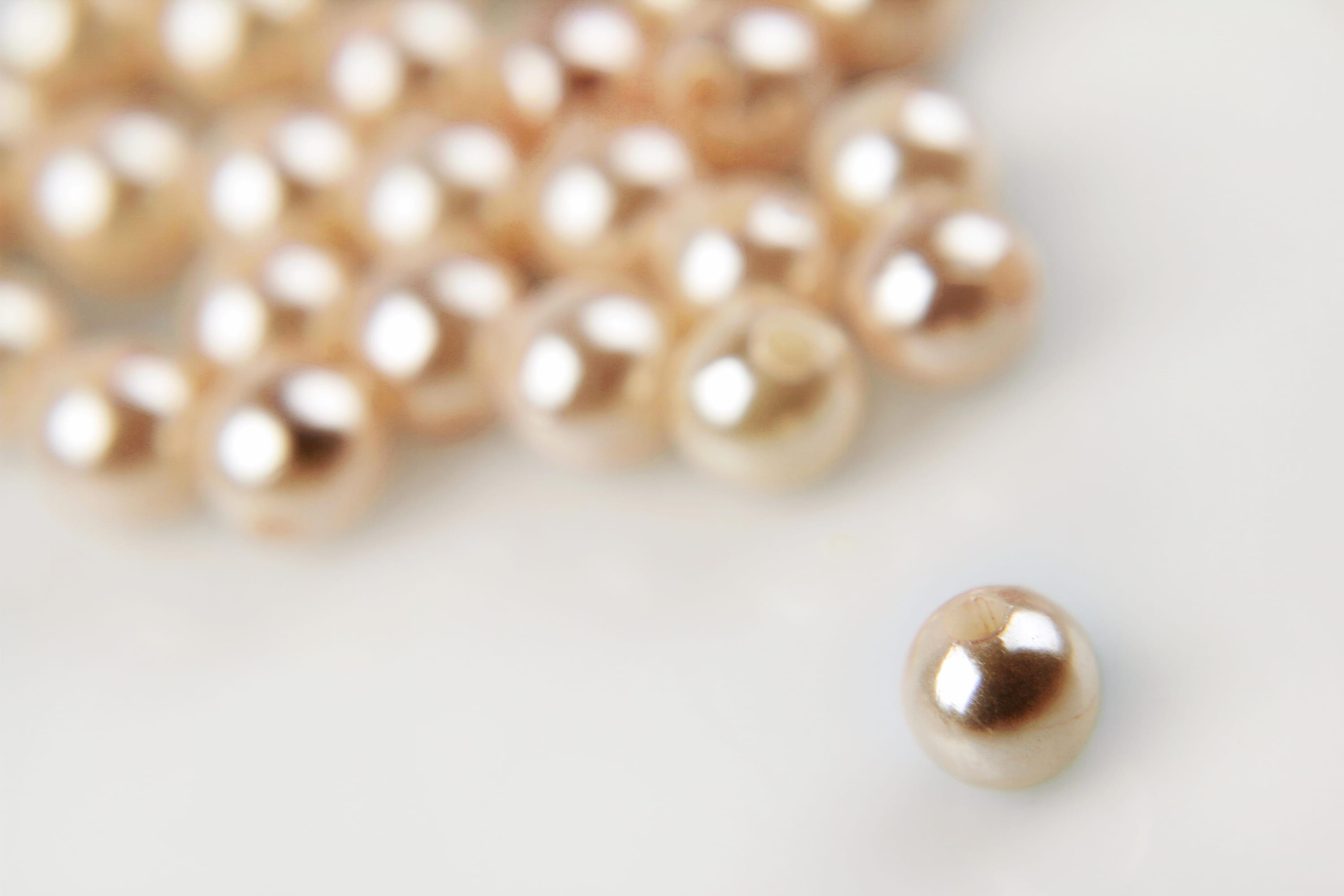 Lots of rose-colored shiny pearls