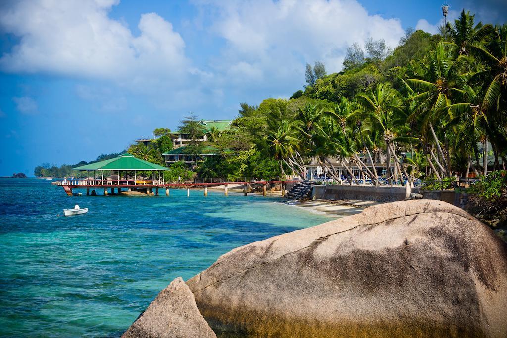 Отель Coco De Mer Hotel Black Parrot Suites, Праслен, Сейшельские Острова