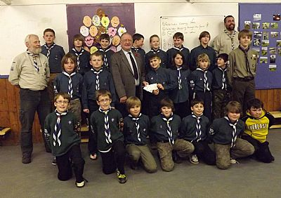 grateful scouts receive the cheque from the scottish accordion music group