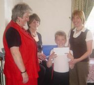 fraser nicoll receiving the £525 cheque