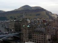 View Over Edinburgh To Salisbury Crags, With Arthur's Seat Behind
