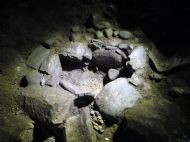 Stone setting (cist?) uncovered in 3 Peaks Cave