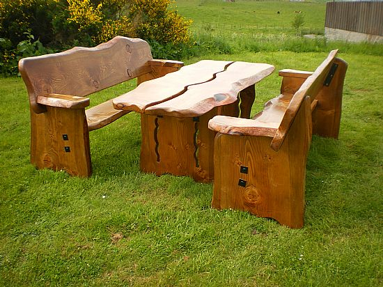 an example of our wooden garden furniture - a table and benches made from quality woods. for rustic garden furniture, speak to us today