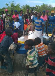 Children enjoying their first taste of their water