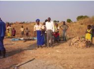 Village Head, Khetamo and wife inspecting the first drilling