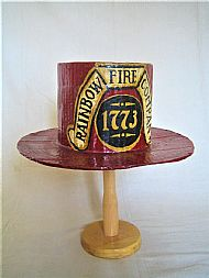 Reproduction stove pipe hat from Rainbow Fire Company, Reading, PA.