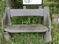 one of the threehand carved villge seats