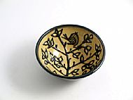 Bird in tree top bowl