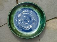 Large flat blue and green fish bowl