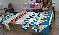 line quilting with pat archibald is coming along grand, well done ladies!