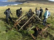 Some of the Waybaggers examining an old piece of farm equipment while on a walk from  Armadale to  Strathy.
