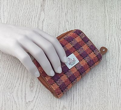 harris tweed purse in hand