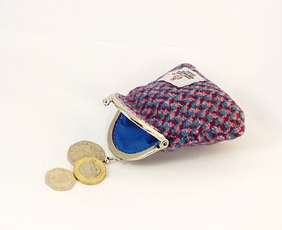detail showing kiss clasp and lining of harris tweed coin purse by roses workshop