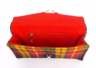 inside of clutch bag has red cotton lining