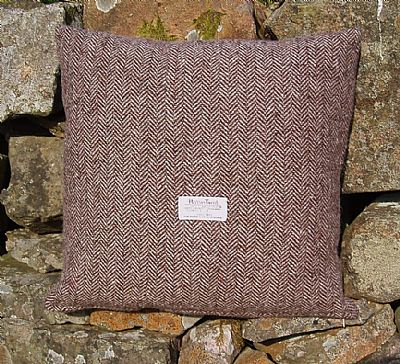 harris tweed brown herringbone cushion showing the orb label