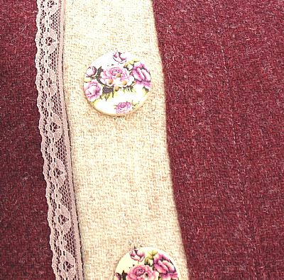 button detail of red rose cushion