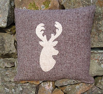 harris tweed brown herringbone cushion with cream stag's head applique