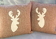 Matching pair of stag cushions