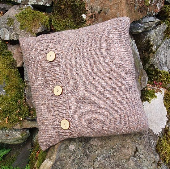 wood slice buttons on brown wool cushion by roses workshop