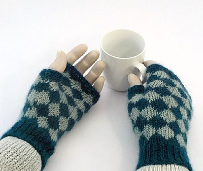 teal and aqua fingerless gloves have pattern all over