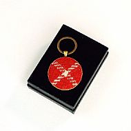 Harris tweed keyring round red white tartan