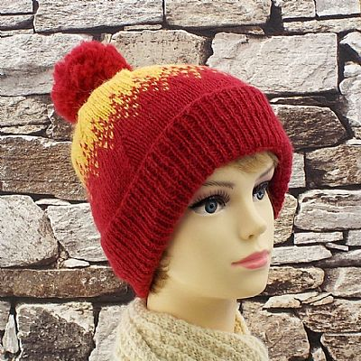 hand knitted red and yellow bobble hat in british exmoor wool by roses workshop