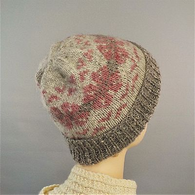 detail of pink and grey fairisle pattern on british wool hat from roses workshop