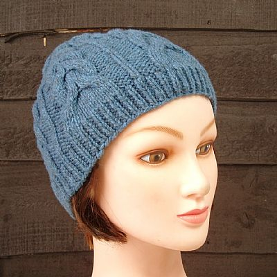 cable design beanie knitted from merino wool in mid-blue