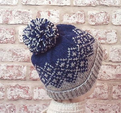 bobble version of grey and blue fairisle beanie by roses workshop